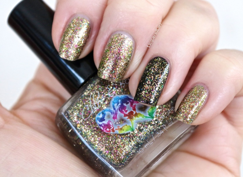 Dragon's Skin is the second in a pair of chrome flakie polishes from Chloe & Bella. Gorgeous flakies in a clear base can be used alone 2-3 coats (I used 2) or over a base color like I did here. I used Chloe & Bella's black creme, Black Out, also available on the web site!