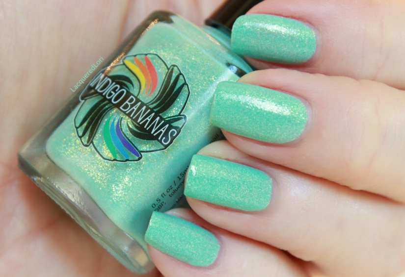 """The Land of Green Ginger from the Spring 2015 collection is a cool minty teal green, buttery smooth teaming with glass flecks. Two coats here. It is described as: """"Land of Green Ginger is a light, mint green creme packed with gold & gold to green colorshifting glass fleck (large size) shimmers, and scattered holo. Very flattering green! This polish is quite a bit lighter than Immortal Game, and a mint color, so quite a bit warmer than the medium teal of Immortal Game, in addition to having a different mix of shimmer."""""""