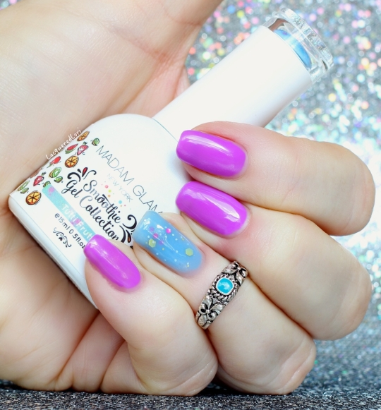 Aren't these Smoothie Gel Collection bottles the cutest?! Here is Tutti Frutti, as seen on my accent nail. Tutti Frutti is described as a Bright Baby Blue Jelly Base with colored Glitters. There are medium gold hex, small fuschia pink hex, tiny gold and silver glitters.