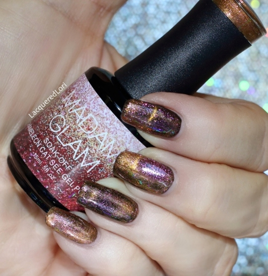 "Madam Glad Chameleon Cat's Eye gel polish is not only striking as a Cat's Eye sparkler, it's also a chameleon so this hybrid has everything going for it. The colors shift from what is described as, Walnut. A beautiful reddish mahogany shade that will make you feel like mystery surrounds you!"" One cured coat over a black gel base, cured. With a magnet, you can create a multitude of designs."