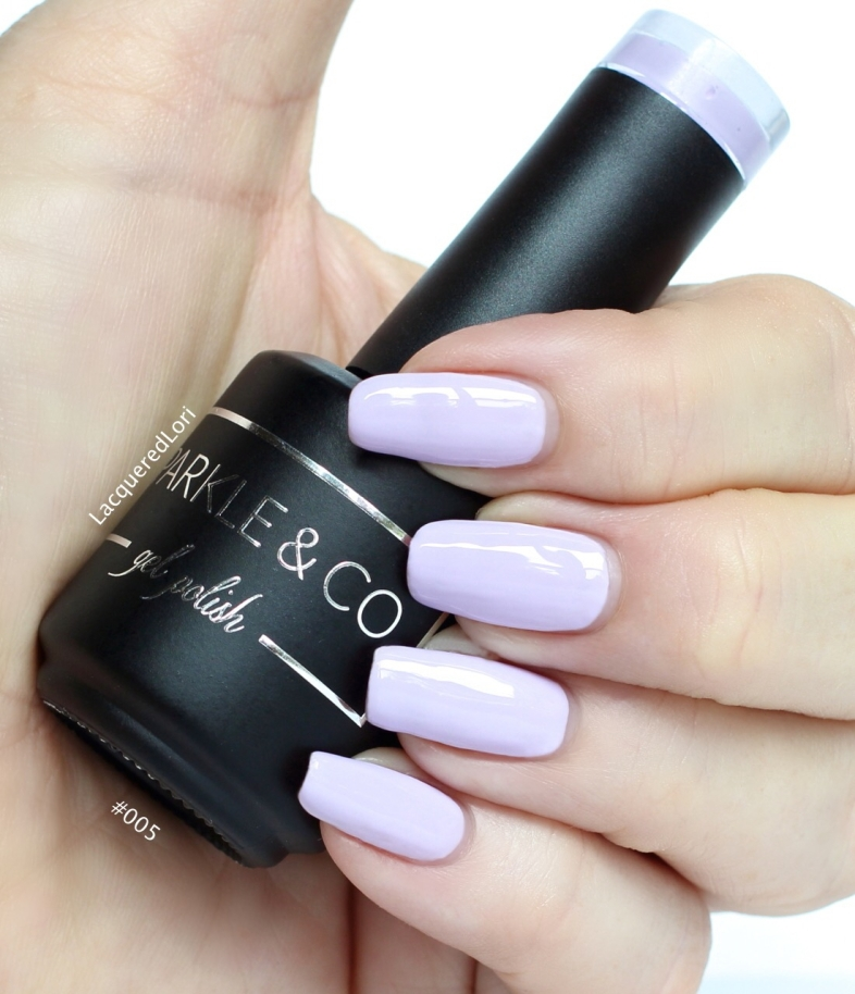 #005 Pastel Purple gel polish by Sparkle & Co is a pale light purple creme. Here she is in two coats. Order yours from Oceansofbeauty.com!