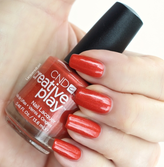 """Here is CND Creative Play™ """"See U in Sienna"""", a glass fleck shimmery burnt orange in two coats."""