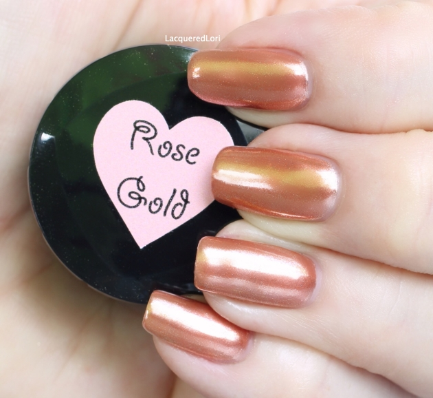 Sparkle & Co Rose Gold Chrome Pure over #35 (light/medium mauve) gel polish. You can purchase both at OceansofBeauty.com. One coat of color and one application of the Rose Gold powder is all you need, then a cured gel top coat. Rose gold with a mirror shine!